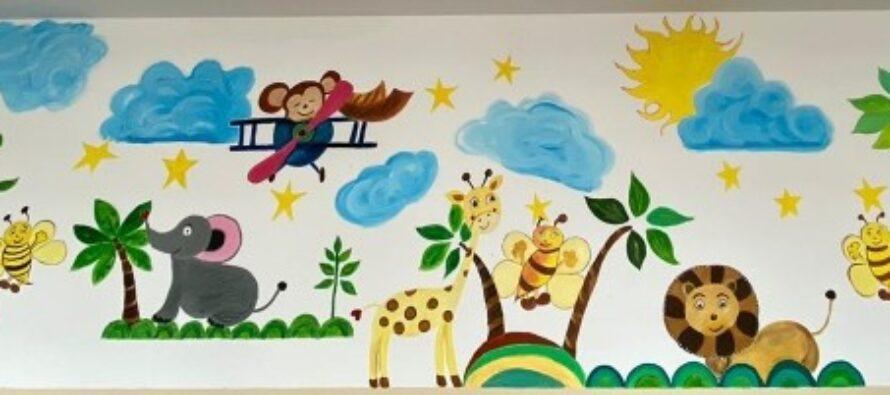 Polițiștii nemțeni au realizat o pictură murală la școala din Gârcina